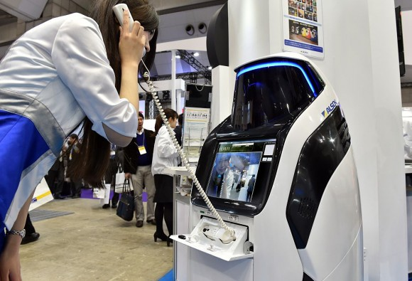"Japan's security company Alsok displays the newly developed security and guide robot ""Reborg-X"", which guides visitors and shoppers in the day time while it patrols a shopping mall autonomously at the annual Security Show in Tokyo on March 4, 2015. Some 170 Japanese and foreign security related companies display their latest products and services at the event. AFP PHOTO / Yoshikazu TSUNO        (Photo credit should read YOSHIKAZU TSUNO/AFP/Getty Images)"