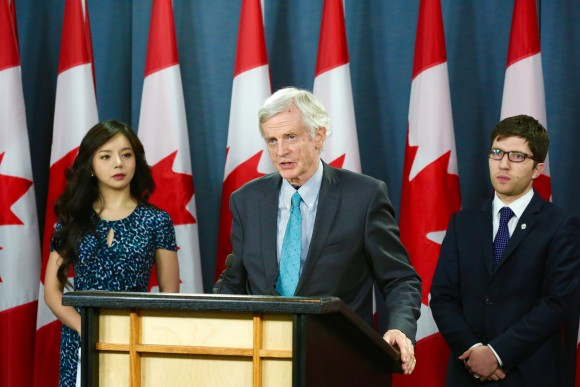(L-R)  Miss World Canada Anastasia Lin, former cabinet minister David Kilgour, and Conservative MP Garnett Genuis at the National Press Theatre in Ottawa on April 4. (Jonathan Ren/Epoch Times)