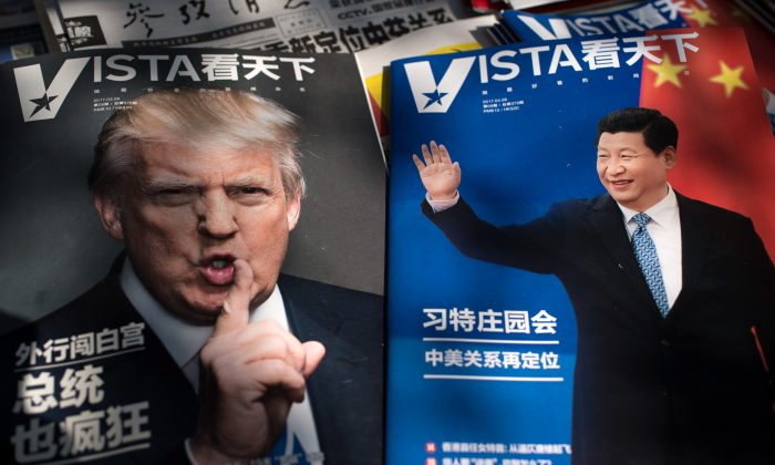 "Magazines featuring front pages of US President Donald Trump (L) and China's President Xi Jinping (R) are displayed at a news stand in Beijing on April 6, 2017. The first summit between US President Donald Trump and his Chinese counterpart Xi Jinping will be of ""great significance"" for global peace, the two countries' top diplomats agreed ahead of the meeting. The two meet at Trump's Mar-a-Largo resort in Florida on April 6 and 7.  (NICOLAS ASFOURI/AFP/Getty Images)"
