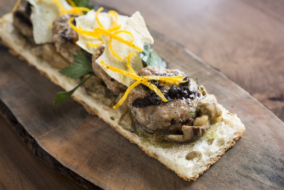 Wild boar meatballs with Mount Etna porcini mushrooms and black truffles. (Samira Bouaou/Epoch Times)