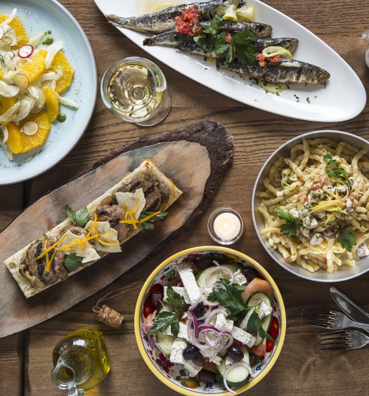 A spread of dishes at Piccola Cucina Estiatorio in SoHo, Manhattan. (Samira Bouaou/Epoch Times)