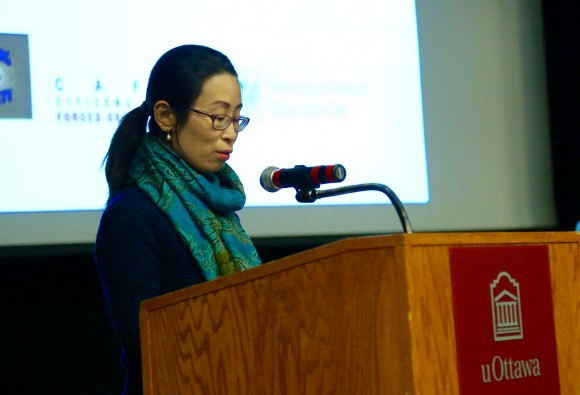 Falun Gong practitioner Hongyan Lu speaks following the screening of
