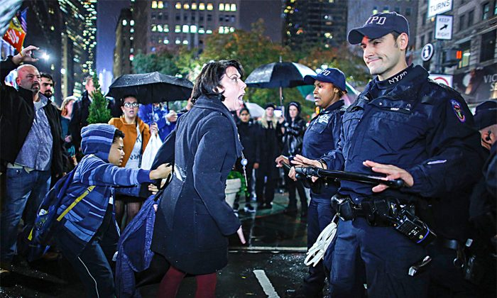 A woman argues with police officers during a protest against President-elect Donald Trump in New York on Nov. 9, 2016. (KENA BETANCUR/AFP/Getty Images)