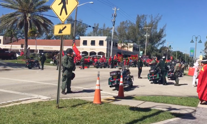 Pro-communist Chinese nationalists outside of the Mar-a-Lago resort where Chinese leader Xi Jinping and U.S. President Donald Trump held bilateral talks on April 7, 2017. The group was playing an anti-American propaganda song. (Epoch Times)