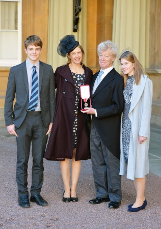 Sir Roger Scruton after he was knighted by the Prince of Wales, along with (L–R) his son Sam, wife Sophie, and daughter Lucy at Buckingham Palace in London on Nov. 25, 2016. (John Stillwell/Getty Images)