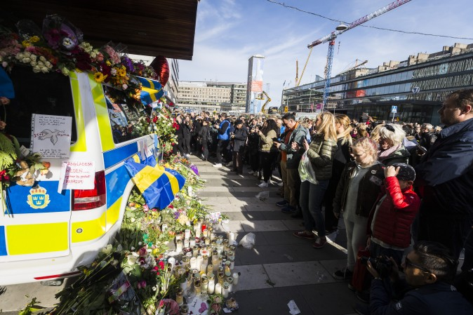 Flowers are left on a police car to show gratitude to law enforcement officers after a peace demonstration on Sergels square in Stockholm, Sweden, on April 9, 2017. An Uzbek man has been arrested and held on terrorism charges following the attack with a hijacked truck which killed four people and injured another 15. (Michael Campanella/Getty Images)