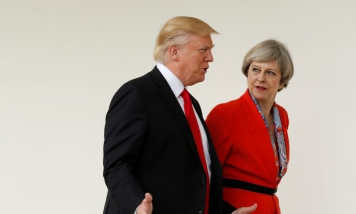 U.S. President Donald Trump escorts British Prime Minister Theresa May after their meeting at the White House in Washington on Jan. 27, 2017. (REUTERS/Kevin Lamarque)