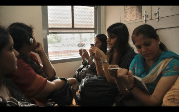 """Ritu (C) on a train in the documentary """"A Suitable Girl."""""""