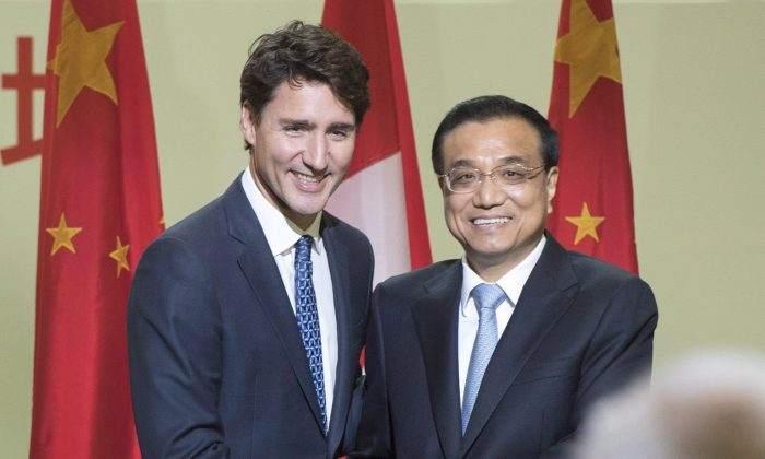 Prime Minister Justin Trudeau and Chinese Premier Li Keqiang shake hands after speaking at a business luncheon in Montreal on Sept. 23, 2016. Two out of three Canadians believe human rights should be linked to free trade negotiations with Beijing, according to a new public opinion survey.  (The Canadian Press/Ryan Remiorz)