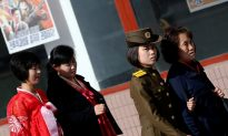 North Korea Displays Might, US Strike Group Approaches
