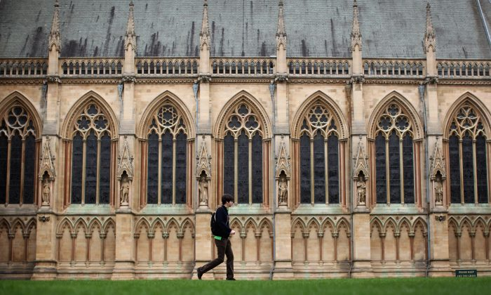 CAMBRIDGE, UNITED KINGDOM - MARCH 13:  A student walks through St John's College on March 13, 2012 in Cambridge, England. Cambridge has a student population in excess of 22,000 spread over 31 different independent Colleges across the city. The city is home to several famous University's, including The University of Cambridge, which was founded in 1209, and is ranked one of the top five universities in the world, King's College Chapel, and Trinity College. Famous alumni have included the likes of Charles Darwin, Isaac Newton, Samuel Pepys and David Attenborough.  (Photo by Dan Kitwood/Getty Images)