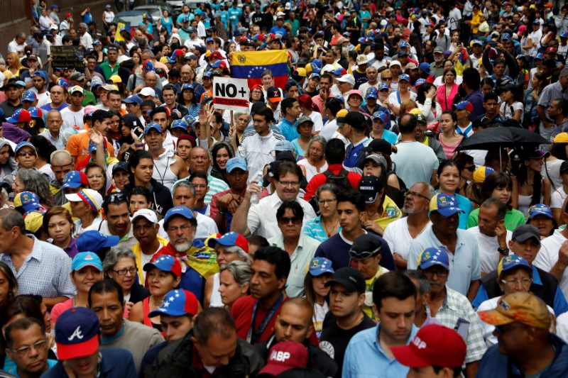 Demonstrators rally against Venezuela's President Nicolas Maduro in Caracas, Venezuela on April 13, 2017. (REUTERS/Carlos Garcia Rawlins)
