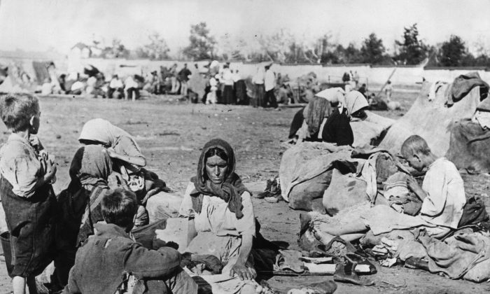 Ragged and barefoot, starving Russian families in the Volga area during the Russian Faminein October 1921.  (Topical Press Agency/Getty Images)