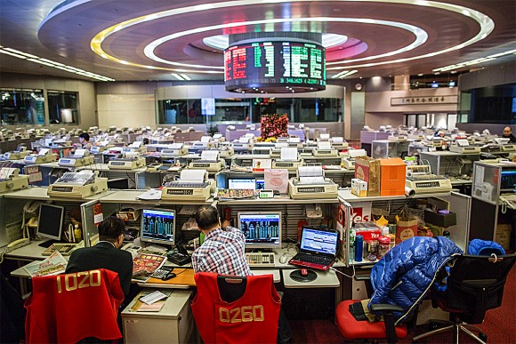 Traders on the trading floor of the stock exchange in Hong Kong on Feb. 3, 2016. The exchange's Q1 2017 IPO value of $5.3 billion is its lowest in 11 years. (ANTHONY WALLACE/AFP/Getty Images)