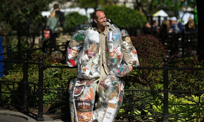 Rob Greenfield, founder of The Food Waste Fiasco, wears a suit  made of every piece of garbage he generates in a month at Union Square Park October 14, 2016 in New York. (Timothy A. Clary/AFP/Getty Images)