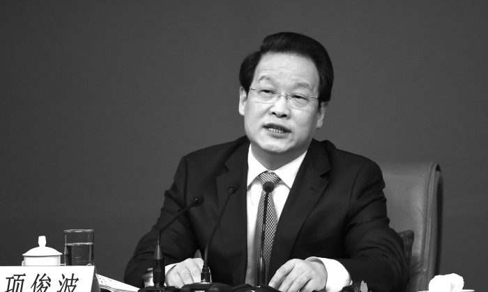 Xiang Junbo, Chairman of China Insurance Regulatory Commission (CIRC) at the National People's Congress in Beijing on March 12, 2016. (WANG ZHAO/AFP/Getty Images)
