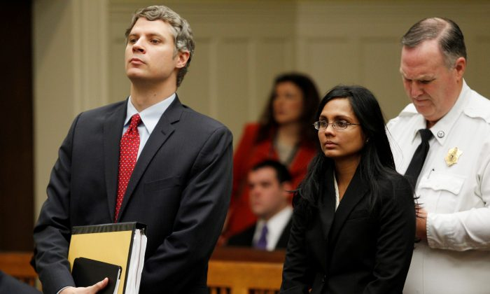 Annie Dookhan, a former chemist at the Hinton State Laboratory Institute, stands beside her lawyer Nick Gordon (L) during her arraignment at Brockton Superior Court in Brockton, Massachusetts on Jan. 30, 2013. (REUTERS/Jessica Rinaldi)