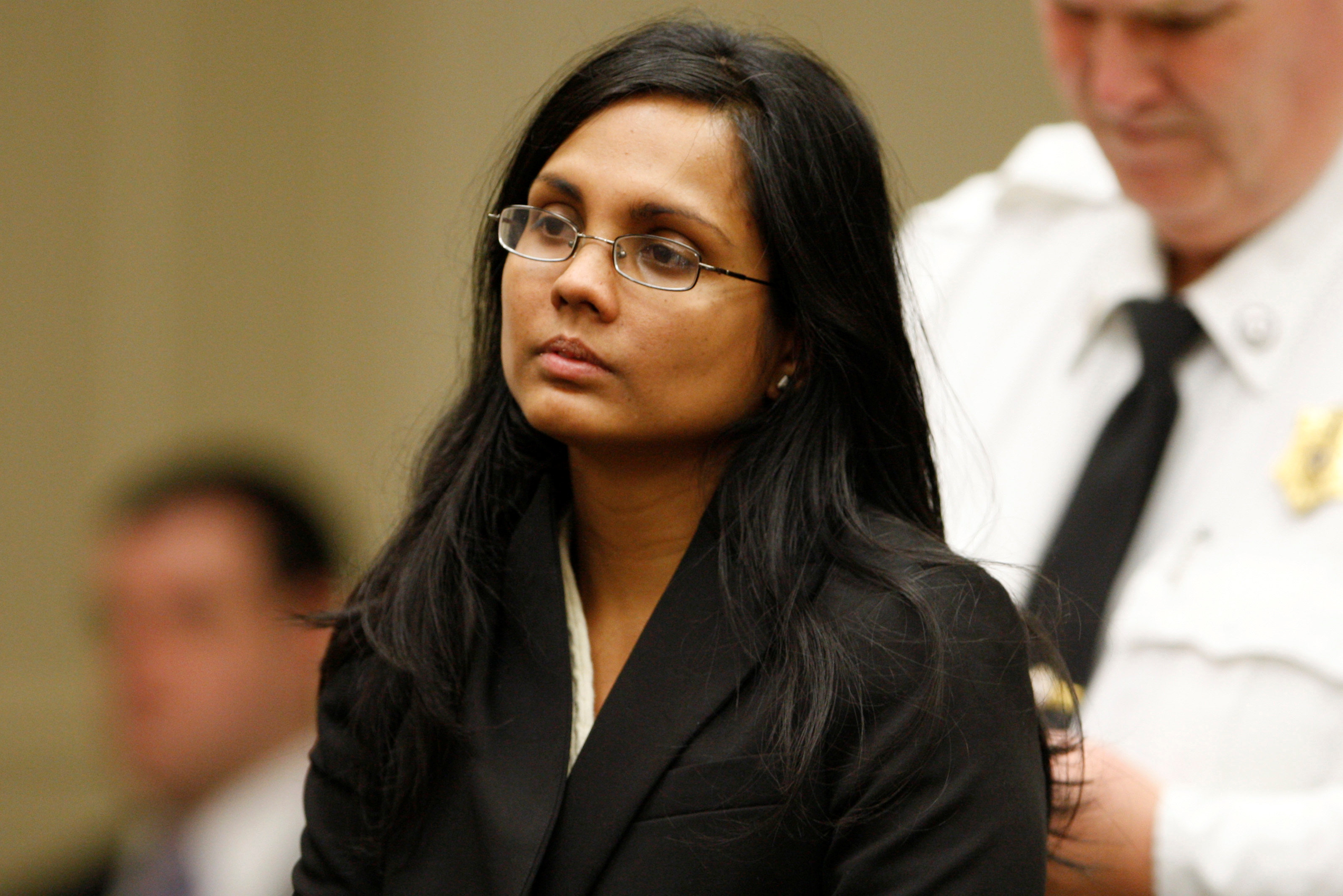 FILE PHOTO: Annie Dookhan, a former chemist at the Hinton State Laboratory Institute, listens to the judge during her arraignment at Brockton Superior Court in Brockton, Massachusetts on Jan. 30, 2013. (REUTERS/Jessica Rinaldi)