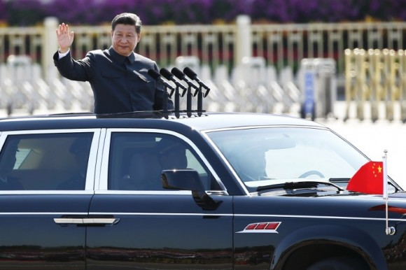 Chinese leader Xi Jinping waves as he reviews the army, at the beginning of the military parade marking the 70th anniversary of the end of World War Two, in Beijing, China on Sep. 3, 2015. (REUTERS/Damir Sagolj)