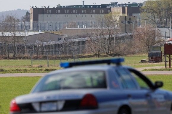 Prison officials patrol the roads around the Souza Baranowski Correctional Center in Shirley, Massachusetts, U.S., where former New England Patriots player Aaron Hernandez was found dead in his jail cell April 19, 2017. (REUTERS/Brian Snyder)