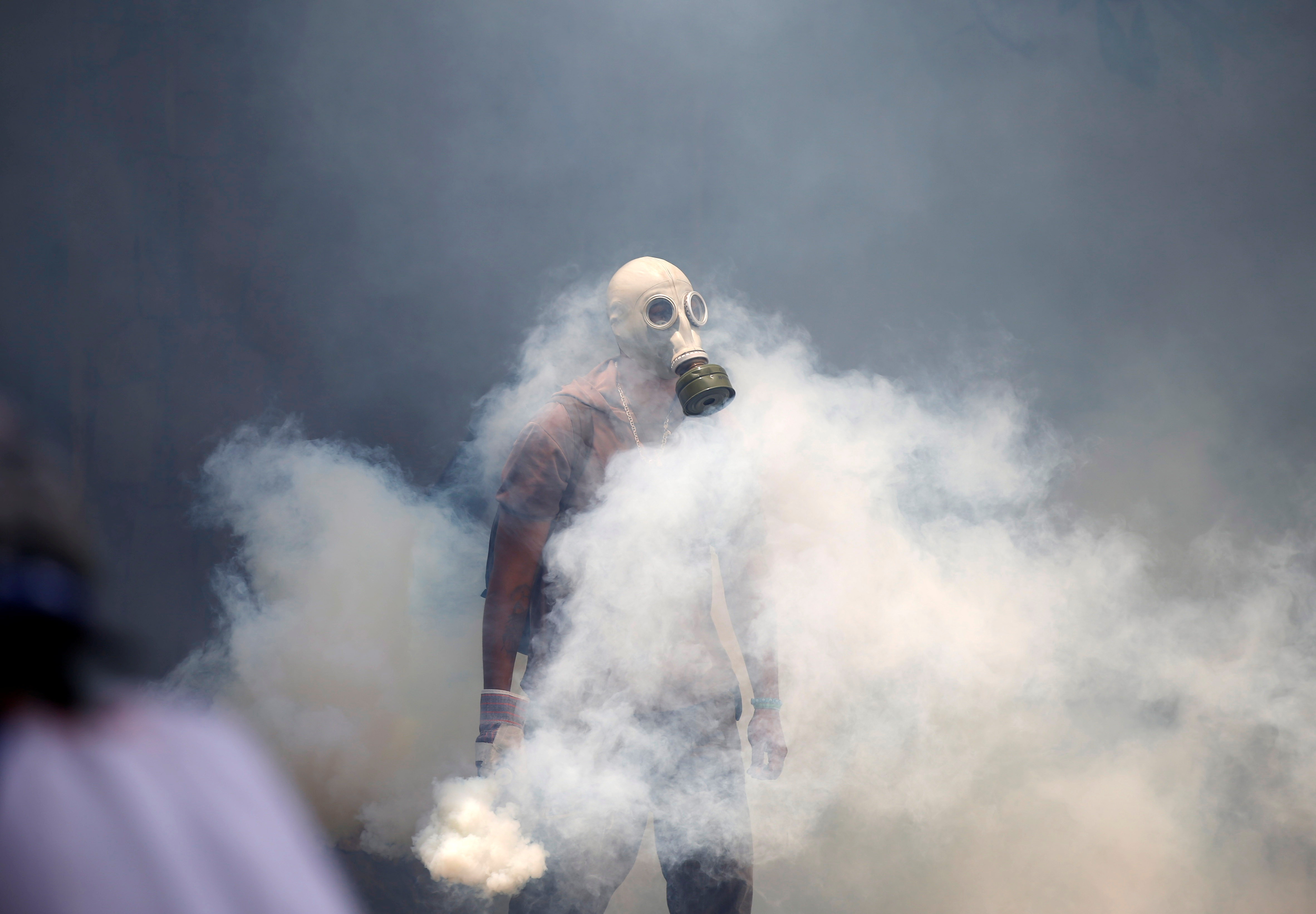 """A demonstrator clashes with riot police during the so-called """"mother of all marches"""" against Venezuela's President Nicolas Maduro in Caracas. (REUTERS/Carlos Garcia Rawlins)"""