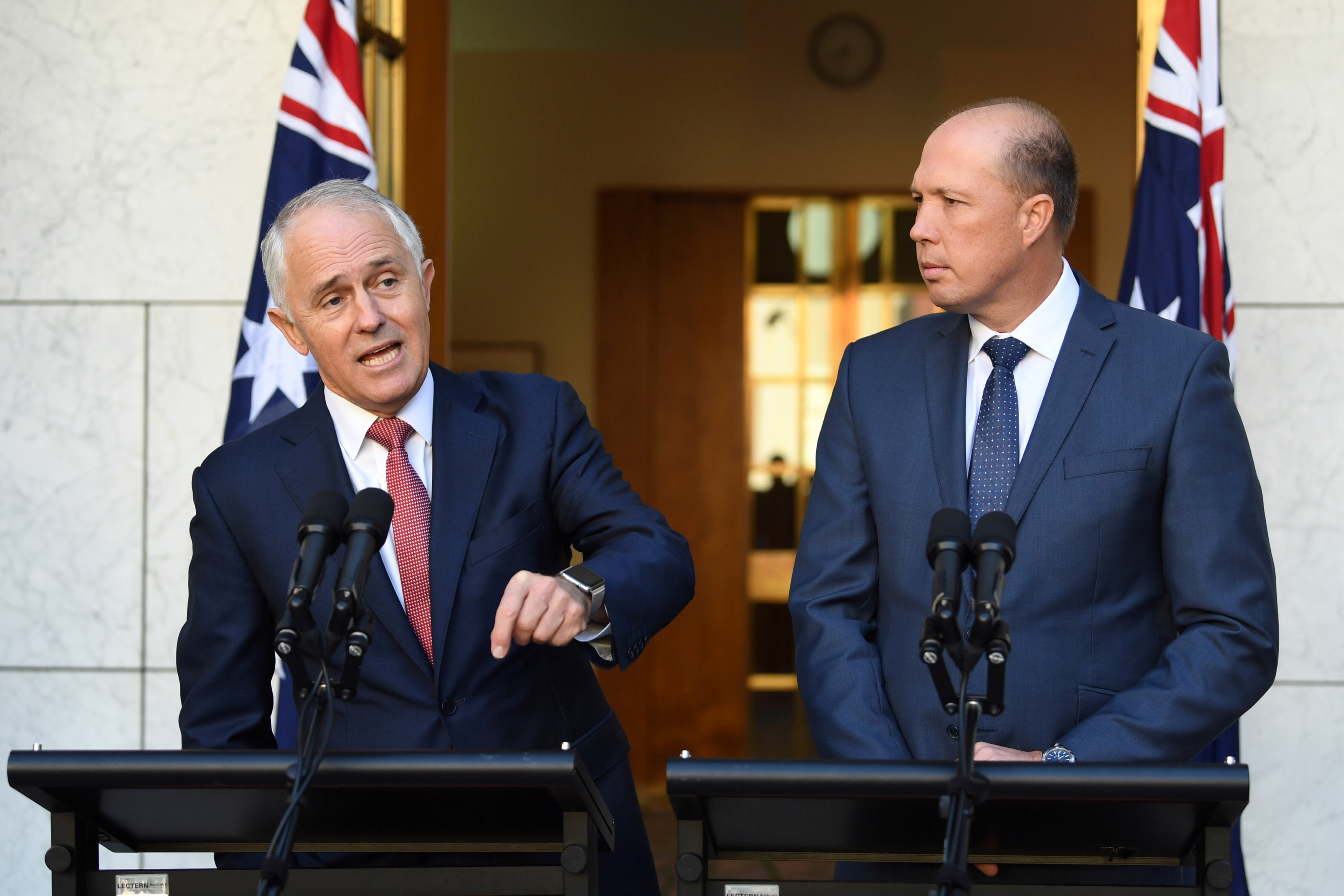 Australia's Prime Minister Malcolm Turnbull (L) and Minister for Immigration and Border Protection Peter Dutton speak on Australia's citizenship test during a press conference at Parliament House in Canberra, Australia on April 20, 2017. (AAP/Lukas Coch/via REUTERS)