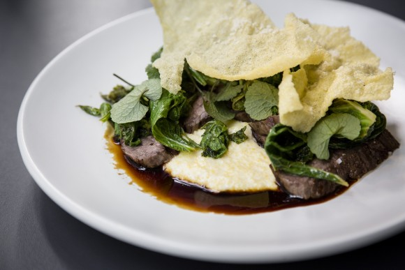 Grilled beef with polenta and mustard greens. (Samira Bouaou/The Epoch Times)