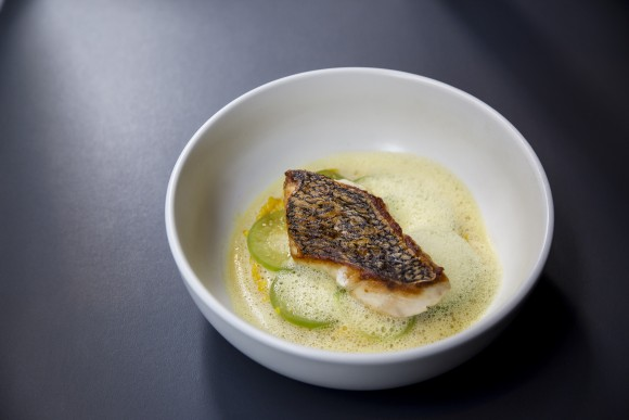 Black bass with green tomatillos, couscous, and lemon thyme broth. (Samira Bouaou/The Epoch Times)
