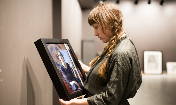"""Colleen Barry, artist and curator, prepares the """"Self Portrait"""" exhibition at Eleventh Street Arts gallery in Long Island City, New York on April 19, 2017. (Samira Bouaou/The Epoch Times)"""