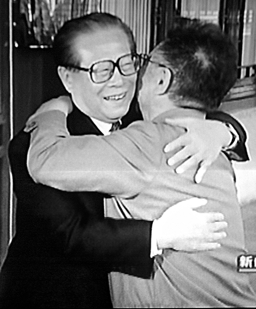 North Korean dictator Kim Jong Il (R) and then-Chinese leader Jiang Zemin embrace during the former's visit to China in April 2004. (CCTV/AFP/Getty Images)