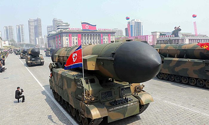 A North Korean ballistic missile launcher on parade in this file photo. North Korea received Chinese aid for its nuclear and rocket programs. (STR/AFP/Getty Images)