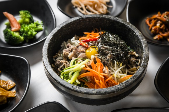 Bibimbap, a popular rice dish with vegetables, is served in a stone pot.(Samira Bouaou/The Epoch Times)