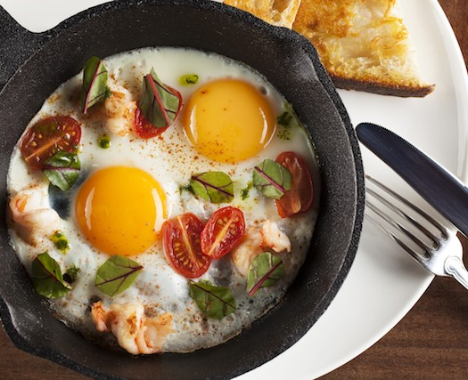 Skillet baked eggs with shrimp. (Courtesy of Coffeemania)