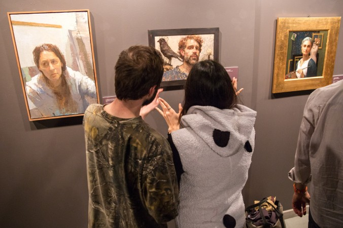 """Artists and guests attend the opening reception for """"Self Portrait"""" at the Eleventh Street Arts gallery in Long Island City, New York on April 20, 2017. (Benjamin Chasteen/Epoch Times)"""