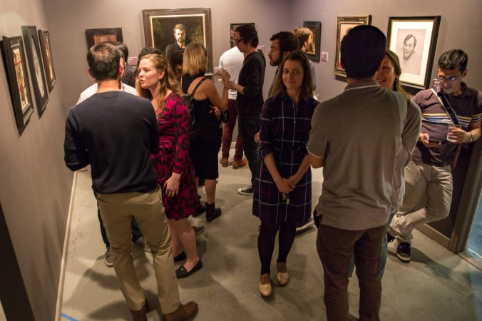 """Artists and guests attend the opening reception for """"Self Portrait"""" at the Eleventh Street Arts gallery in Long Island City, New York, on April 20, 2017. (Benjamin Chasteen/Epoch Times)"""