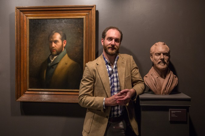 """Artist Brendan Johnston with his work at the opening reception for """"Self Portrait"""" at the Eleventh Street Arts gallery in Long Island City, New York, on April 20, 2017. (Benjamin Chasteen/Epoch Times)"""