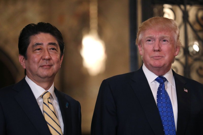 Japanese Prime Minister Shinzo Abe and U.S. President Donald Trump pose for a photograph before attending dinner at Mar-a-Lago Club in Palm Beach, Fla., on Feb. 11, 2017. (REUTERS/Carlos Barria)