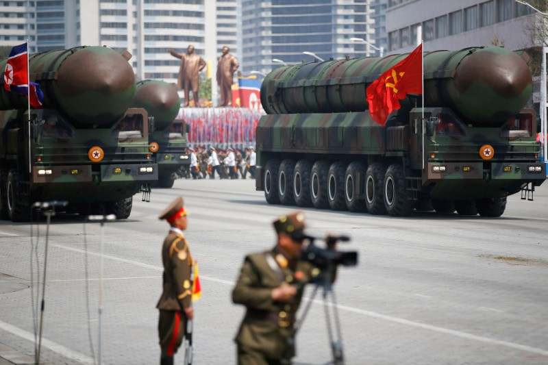 Intercontinental ballistic missiles (ICBM) are driven past the stand with North Korean leader Kim Jong Un and other high ranking officials during a military parade marking the 105th birth anniversary of country's founding father Kim Il Sung, in Pyongyang on April 15, 2017. (REUTERS/Damir Sagolj)