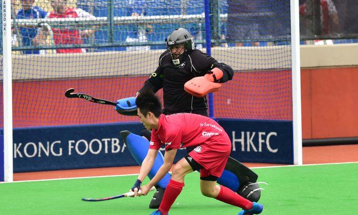 YU Chi Wai scores Shaheen-A's 2nd goal during their 4-3 win in the Holland Cup quarter final against HKFC-B at HKFC on Sunday April 23, 2017. (Bill Cox/Epoch Times)