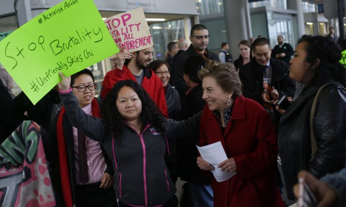 Congresswoman Jan Schakowsky (D-IL) greets protesters against United Airlines at O'Hare International Airport on April 11, 2017 in Chicago, Illinois.  The protest was in response to airport police officers physically removing passenger Dr. David Dao from his seat and dragging him off the airplane, after he was requested to give up his seat for United  (JOSHUA LOTT/AFP/Getty Images)