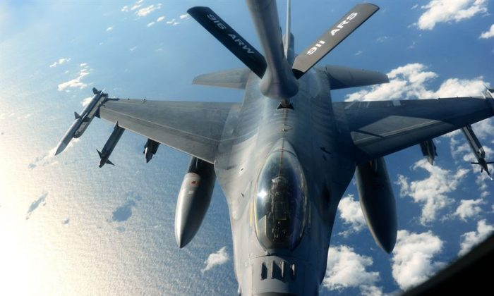 An F-16 Fighting Falcon receives fuel from a KC-135R Stratotanker during exercise Razor Talon Dec. 14, 2015, over the coast of North Carolina. The aircrew and other support units from multiple bases conducted training missions designed to bolster cohesion between forces. (U.S. Air Force photo/Senior Airman John Nieves Camacho)