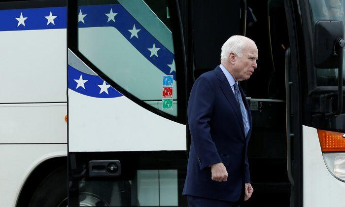U.S. Senator John McCain (R-AZ) boards a Senate caravan bus from Capitol Hill to attend a North Korea briefing at the White House, in Washington, U.S., April 26, 2017. REUTERS/Yuri Gripas