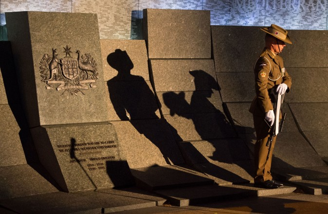 The shadow of a soldier falls on the Australian War Memorial during an Anzac Day dawn service at the Australian War Memorial in London, England, on April 25, 2017. The annual event marks the anniversary of Australia and New Zealand first seeing military action during the First World War. (Dominic Lipinski - WPA Pool /Getty Images)