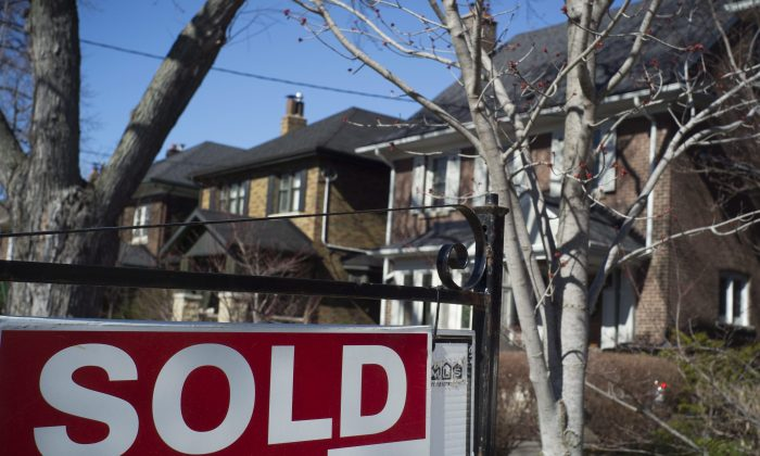A sold sign is seen in front of a west-endToronto home on April 9, 2017. Toronto's overheating housing market should not be an impediment to kick-starting a private-label mortgage-backed securities market, according to two mortgage industry experts. (The Canadian Press/Graeme Roy)