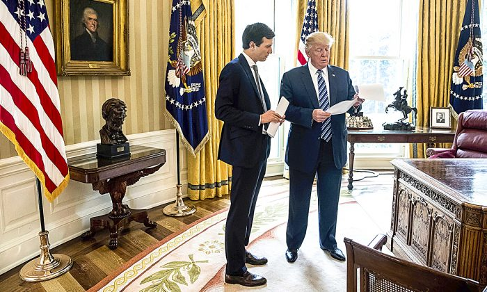 President Donald Trump speaks to son-in-law and White House senior adviser Jared Kushner in the Oval Office of the White House on April 21. (AP PHOTO/ANDREW HARNIK)
