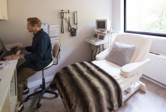 Dr. Anthony Lyon at treatment room desk at The Ash Center. (Photo courtesy of The Ash Center)