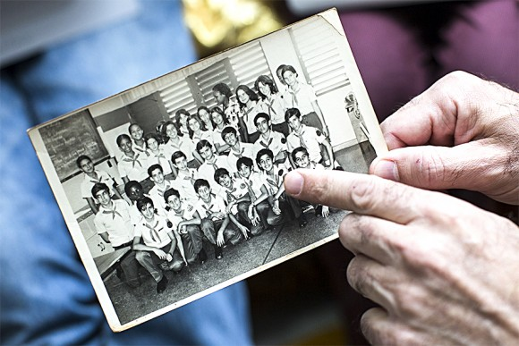 Jesús de León points to himself in a photo from when he was in seventh grade at Lenin High School. De León was forced to turn against his friends if they were planning to leave Cuba. (Samira Bouaou/The Epoch Times)
