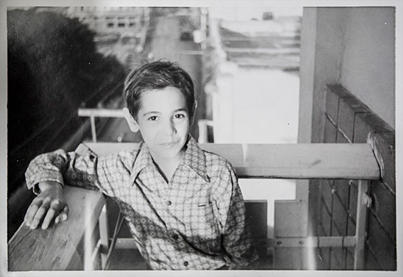 Jesús de León as a young boy on his aunt's balcony in Havana in the early 1970s. (Courtesy of Jesús de León)