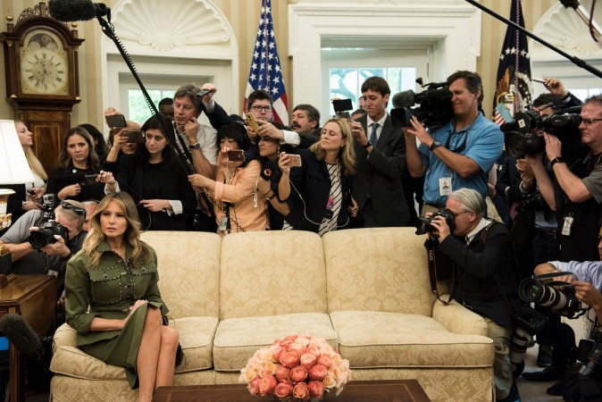 First Lady Melania Trump listens while President Donald Trump speaks to the press before a meeting with Argentina's President Mauricio Macri in the Oval Office of the White House on April 27. (BRENDAN SMIALOWSKI/AFP/Getty Images)