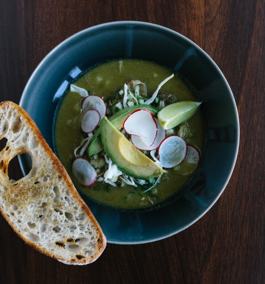 Pozole hominy soup with pork, avocado, poblano chili peppers, and radish. (Ethan Covey)